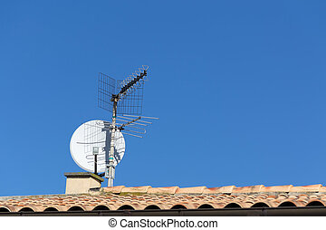 tv antenna on a house roof
