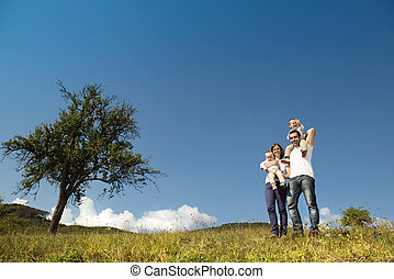 Happy family in nature - Happy family relaxing together in...