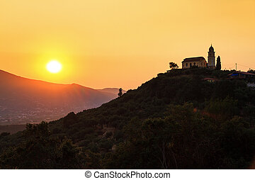 Church at sunset - Beautiful sunset with a church on top of...
