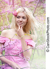 Young woman in spring park - Smiling young woman with blonde...
