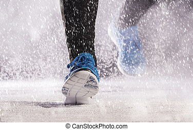 Man running in winter - Athletic man is running during...