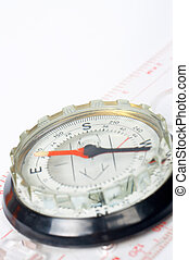Compass with focus on the south over a white background....