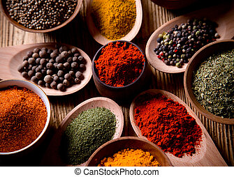 Assorted spices on wooden background