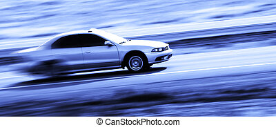 Driving a Speedy Car - Speedy four door sedan driving along...