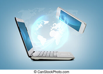 smartphone and laptop conncecting - technology and internet...