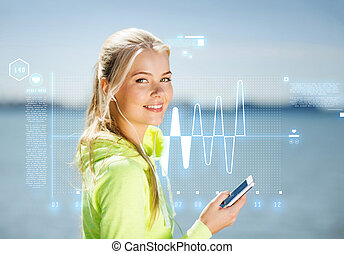 woman listening to music outdoors - fitness and lifestyle...