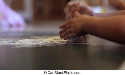Little girl kneading dough People - Little girl kneading...