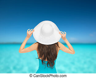 model in swimsuit with hat - vacation and summer holidays...