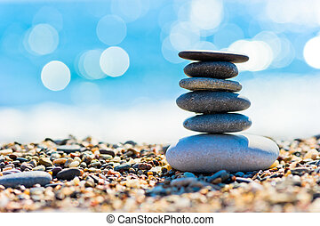 pebble beach and gray spa stones in the form of a tower