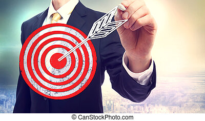 Business man drawing target with chalk