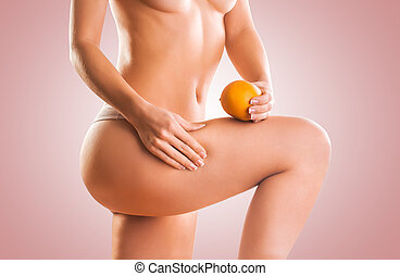 naked girl with orange. cellulite - naked girl with orange