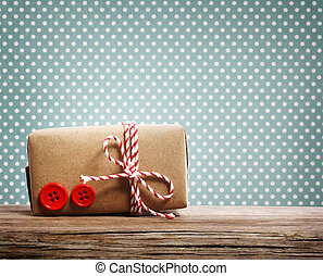 Hand made gift box over blue polka dots background