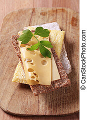 Crispbread and Swiss cheese - Variety of crispbread and a...