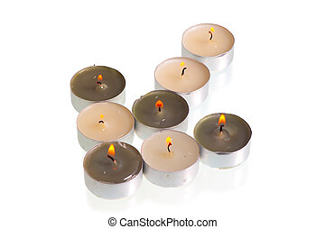 burning candles form a arrow on a white background