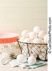 Fresh Eggs In A Wire Basket - Several fresh eggs rest in a...