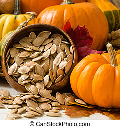 Orange Pumpkins With Toasted Pumpkin Seeds - Colorful orange...