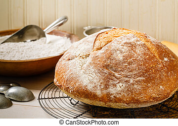 Rustic Artisan Bread - Round rustic artisan bread rests on a...