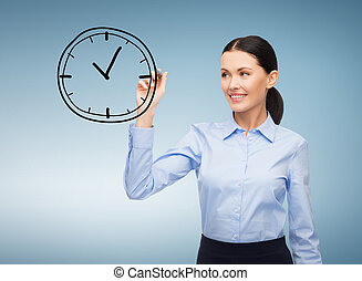 businesswoman drawing clock in the air - office, business...