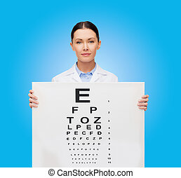 calm female doctor with eye chart - healthcare,...