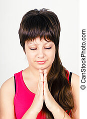 Young attractive girl praying