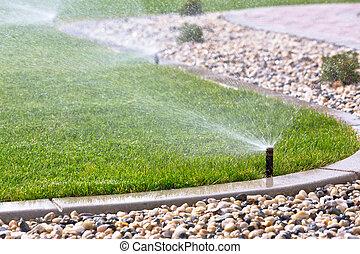 sprinklers - Sprinklers watering grass