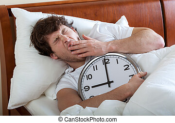 Man waking up - Man holding a big clock and waking up
