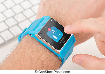 Smart watch on male hand with like icon - Male finger taps...