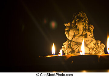 lord ganesha in lamplight - lord ganesha with oil light...