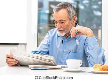 Senior man with newspaper