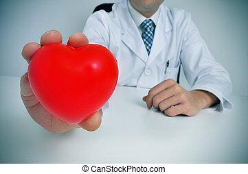 cardiovascular health - a man wearing a white coat sitting...