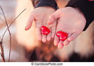 Love story concept - Woman's and men's hands holding pair of...