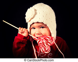 Baby with lolly pop - Beautiful baby girl eating a heart...