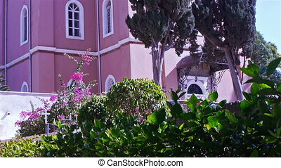 Beautiful flowers near Saint Peters orthodox church in...
