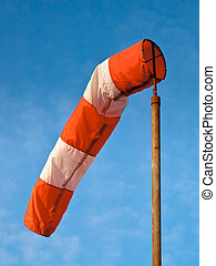 Wind Sock Blue Sky - Wind Sock against Blue Sky with Fluffy...