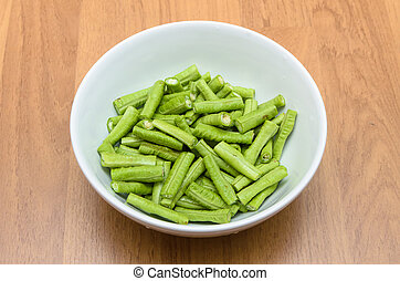 Chopped string beans in white bowl prepare for cooking
