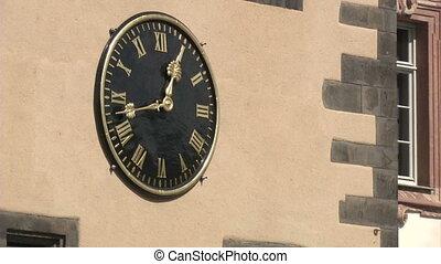Clock on church in Frankfurt, Germany