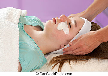 Practitioner Doing Chemical Youth Peel - Cropped image of...