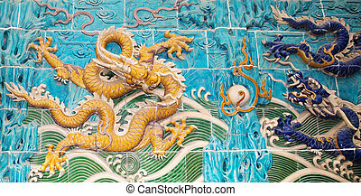 Dragon sculpture. The Nine-Dragon Wall (Jiulongbi) at Beihai...