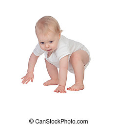 Adorable blonde baby in underwear crawling isolated on a...