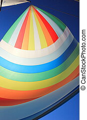 The wind has filled colorful spinnaker sail - The wind has...