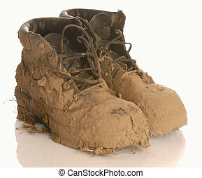 muddy work boots - muddy work boot isolated on a white...