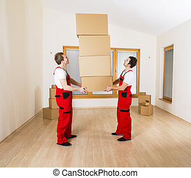 Movers in new house with lot of boxes