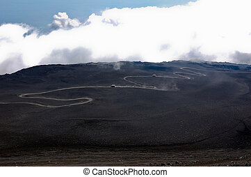 Scenic views at Etna vulcano with serpentine road