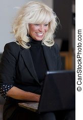 Businesswoman working at home on a laptop