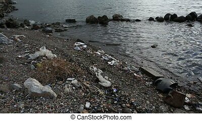 rubbish at the beach - polluted seaside, water pollution
