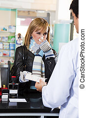 pharmacy - sick woman giving prescription to pharmacist