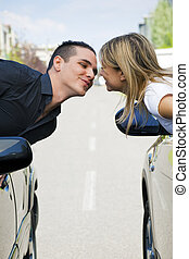 car series - couple leaning out of car windows and kissing...