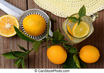 Fresh Squeezed Lemonade on a rustic wooden table with...