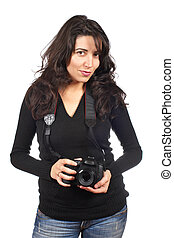 Woman photographer - Young woman photographer holding a...