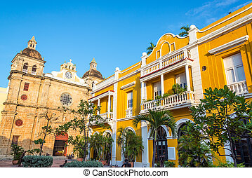 San Pedro Claver Plaza - Church and yellow colonial building...